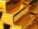 Gold Bulls Raise Wagers Most in Month on Stimulus